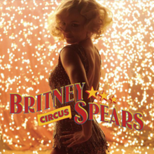 "The torso of a younge blond woman with wavy blond haircut wearing a sparkly golden dress. She is looking over her shoulder, with her left hand resting on her left hip. In the back, there is a shower of sparks. The words ""BRITNEY"" followed by three yellow stars and ""SPEARS"" are written in capital red circus-like handwriting. Below ""BRITNEY"", the word ""CIRCUS"" is written in smaller capital letters."