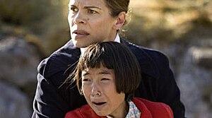 Eksperimentet - Scene from the film: Karen (portrayed by Laura Skaarup Jensen) taken away from her parents by Nurse Gert (portrayed by Ellen Hillingsø)