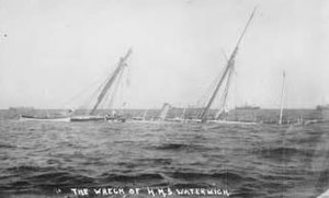 HMS Waterwitch (1892) - Waterwitch awash at low water at Singapore, 1912