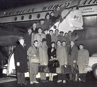 Lenny Hambro - The New Glenn Miller Orchestra, with vocalist Lorry Peters flanked by Hambro and Ray McKinley, boarding a flight to Europe in 1957.