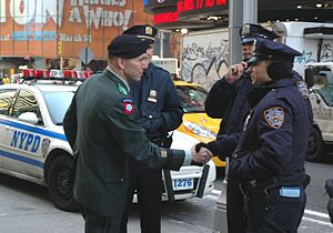 William B. Caldwell - New York City policemen are greeted by Caldwell as he visits the Times Square Military Recruiting Station on March 10, 2008.