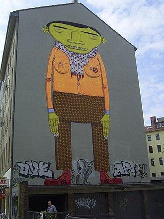 OSGEMEOS - Mural graffiti by OSGEMEOS in Berlin