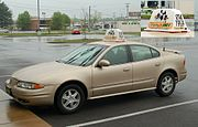 An Oldsmobile Alero being used to deliver a pizza. Note the sign on the car's roof.