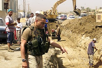 Civil affairs - A civil affairs soldier with the 411th Civil Affairs Battalion assesses the reconstruction of sewage lines in Baghdad June 11, 2003.