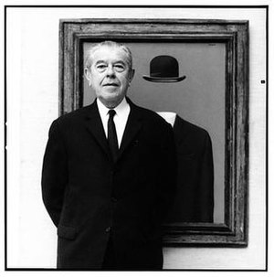 René Magritte - Portrait of Magritte in front of his painting The Pilgrim, taken by Lothar Wolleh in 1967