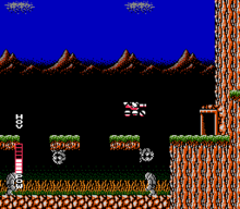 A pink vehicle (which is SOPHIA THE 3RD) is in the center of the screen, jumping from a floating platform to a door on the right side of the screen. Below the floating platform are grey wall-walking enemies, a grey statuesque walking enemy, and a swamp-like bottom. The background consists of mountains in a dark blue sky.