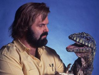 Carnosaur (film) - Promotional photo of John Carl Buechler with his Deinonychus puppet
