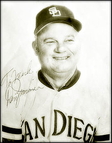 "A middle-aged man wearing a light-colored San Diego baseball uniform; the photograph bears a signature saying ""Don Zimmer"""