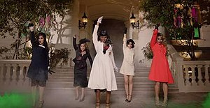 I'm in Love with a Monster - The members of Fifth Harmony dressed in 1940s style attire, dancing in front of a hotel in reminisence of a Halloween theme.