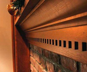 Fireplace mantel - Modern wooden fireplace mantel in a suburban American home.