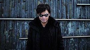 "RaelSan - Orelsan as ""RaelSan"" in the music video."