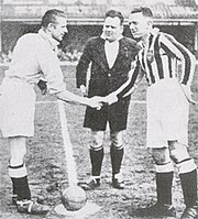 Doherty (left), in his Manchester City days, shaking hands with Jimmy Hampson, of his first club, Blackpool, in the late 1930s. The two were former teammates at Blackpool.