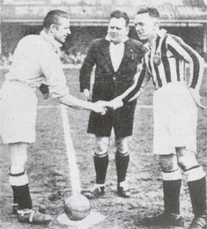 Jimmy Hampson - Hampson (right), shaking hands with former Blackpool forward Peter Doherty, of Manchester City, in the late 1930s.