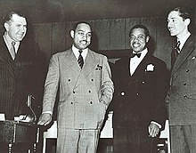 Robert Goffin, Benny Carter, Louis Armstrong, Leonard Feather 1942.jpg