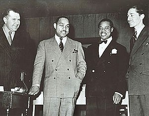 Leonard Feather - Robert Goffin, Benny Carter, Louis Armstrong, and Leonard Feather (L to R) in 1942