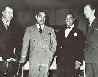 Benny Carter - Carter stands with Robert Goffin, Louis Armstrong, and Leonard Feather in 1942.