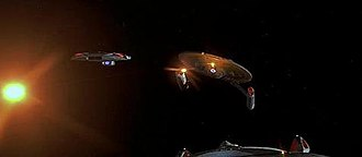 Weapons in Star Trek - An Akira-class starship fires photon torpedoes.