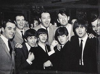 WMCA (AM) - Image: WMCA Good Guys team with the Beatles, 10 February 1964, Plaza Hotel, New York City