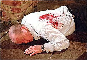 Phil Mitchell - Phil Mitchell immediately after being shot.