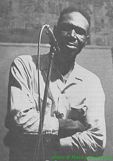 Woodrow Adams American Delta blues guitarist and harmonica player