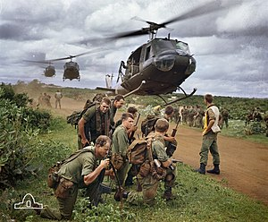 Australian soldiers from 7 RAR waiting to be picked up by US Army helicopters following a cordon and search operation near Phuoc Hai in 1967.
