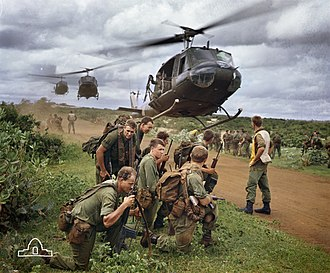 Military history of Australia during the Vietnam War - Australian soldiers from 7 RAR waiting to be picked up by US Army helicopters following a cordon and search operation near Phước Hải on 26 August 1967. This image is etched on the Vietnam Forces National Memorial, Canberra.