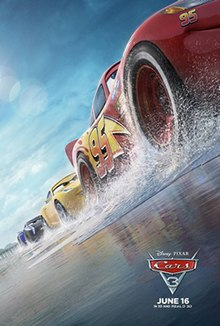"Three anthropomorphic cars race along a beach. The first car is red with the yellow number ""95"" on his side, the second is yellow, and the third is black, with a pier the is visible from behind them. The first one, Lightning McQueen is the main protagonist of the series."