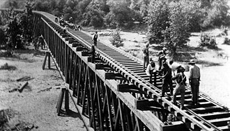 Los Angeles and San Gabriel Valley Railroad - Two groups of men building the railroad over the trestle on the Los Angeles and San Gabriel Railroad, crossing into Pasadena in 1885.