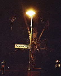 A gas lamp quietly hisses on a former East Berlin street in 2005. A few cities around the world still use gaslight.