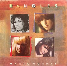 "Four pictures of four women placed in a multicolor background. The words ""Bangles"" and ""Manic Monday"" are written in white capital letters. The upper left photo contain a woman with white face and black hair. The upper right photo is about a red-haired woman. The girl of the third picture, located lower left, is blonde, while the girl of the lower right is a brunette."