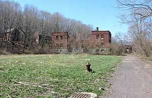 Fort Andrews - The parade ground and the ruined Administration Bldg.