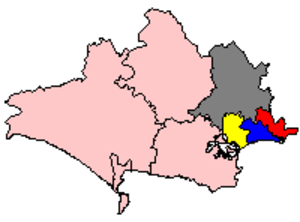South East Dorset conurbation - Shown within Dorset: the towns of Poole (yellow), Bournemouth (blue) and Christchurch (red) form the main centres of the conurbation, which also spreads into East Dorset (grey) to the north and the New Forest district of Hampshire (not shown) to the east.