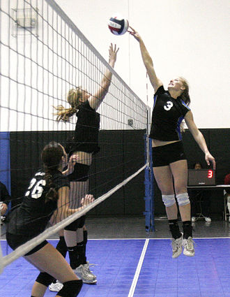 """Volleyball jargon - A player """"tips"""" the ball over."""