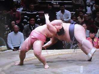 Kimarite - Ura (red) performing Tasukizori against Amakaze (blue) in Jan 2017; the first in the Juryo division and first in 65 years in professional sumo