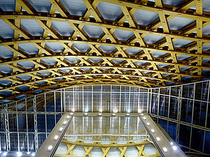Centre Pompidou-Metz - Interior view of the carpentry structure at night. On the Gallery 1's roof, Daniel Buren, Echo of Echos, in December 2011