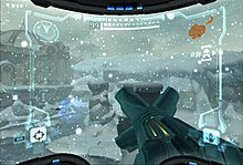 A video game screenshot. A weapon points outwards towards a snowy landscape.