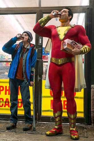 Captain Marvel (DC Comics) - Zachary Levi (right) as Shazam in the 2019 film of the same name, with Jack Dylan Grazer (left) as Freddy Freeman.