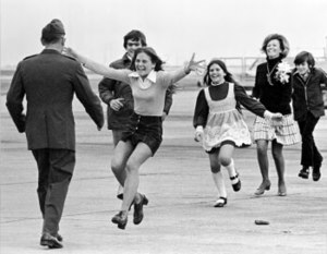 Burst of Joy - The photograph Burst of Joy. From left to right, Lt Col Robert L. Stirm, Lorrie Stirm, Bo Stirm, Cindy Stirm, Loretta Stirm, and Roger Stirm. (© Slava Veder / Associated Press)
