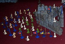 Pieces from several sets of Crossbows and Catapults, including warriors, flags, bricks, and towers