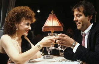 Angie Watts - Angie and Den have dinner together on the Orient Express (1986).