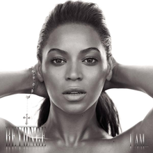 "The cover of the album ""I Am... Sasha Fierce"" features the face of Beyoncé. She is looking directly to the camera while she keeps her hands behind her head. Her hair is combed with a ponytail, and she wears a bracelet on her right wrist. At the lower left corner her first name is written in capital silver letters, while ""I Am..."" is written with the same pattern at the right corner."