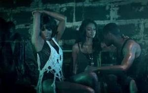 Motivation (Kelly Rowland song) - One of the blue light-tinged scenes from the video, where Rowland sings seductively, while other people get romantic in the background.