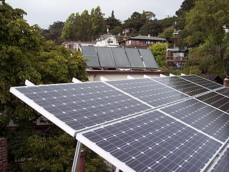 Solar power in California - Photovoltaic (foreground) and Solar water heating (rear) panels located on rooftops in Berkeley, California.  Note the low tilt of the photovoltaic panels, optimized for summer, and the high tilt of the water heating panels, optimized for winter.