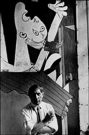 David Seymour (photographer) - Pablo Picasso in Front of Guernica, 1937, by Chim.