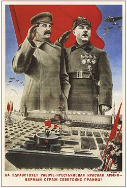 """Joseph Stalin and Kliment Voroshilov depicted saluting a military parade in Red Square above the message """"Long Live the Worker-Peasant Red Army— a Dependable Sentinel of the Soviet Borders!"""""""