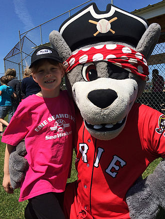 Erie SeaWolves - C. Wolf with youth softball player in June 2015.