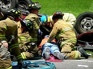 Certified first responder - Volunteer Firefighters trained as Medical First Responders (MFRs) extricate and treat a car accident victim