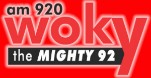 WOKY - WOKY's Mighty 92 logo from 2007–2008, patterned after a former logo the station used in the 1960s.