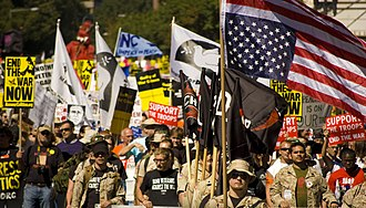 Opposition to the Iraq War - Iraq Veterans Against the War demonstrate in Washington, D.C. on September 15, 2007. The U.S. flag is displayed upside-down, which under the flag code is a distress signal.