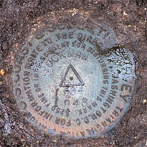 Fort Ruckman - The geodetic disk (PID MY0039) set in the ground above the galleries of Battery Gardner at Fort Ruckman. Its approximate position is marked on the map above.